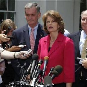 U.S. Sen. Lamar Alexander (R), U.S. Sen. Lisa Murkowski (2nd R), and U.S. Sen. Judd Gregg (3rd R) talk after meeting with U.S. President Barack Obama and a bipartisan group of U.S. Senators to discuss passing comprehensive energy and climate legislation in Washington in this June 29, 2010 file photo.   REUTERS/Larry Downing