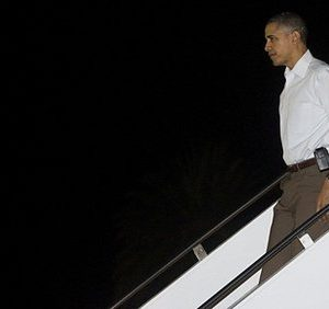 Obama leaves Air Force One for a stop at church (AFP)