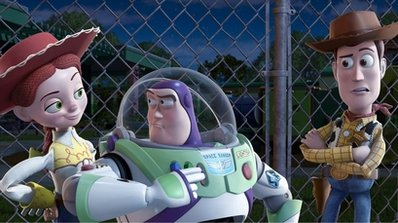 """In this film publicity image released by Disney, from left, Jessie, voiced by Joan Cusack, Buzz Lightyear, voiced by Tim Allen and Woody, voiced by Tom Hanks are shown in a scene from """"Toy Story 3.""""  Domestic box-office revenues for 2010 won't quite hit last year's record-setting haul, but they'll be awfully close. Total movie-ticket sales will reach $10.556 billion, the tracking agency Hollywood.com said Tuesday, Dec. 28, 2010.   """"Toy Story 3"""" was the highest-grossing film released in 2010, earning nearly $415 million. (AP Photo/Disney Pixar)"""