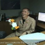 In this frame grab taken from video obtained by the Virginian-Pilot newspaper, U.S. Navy Capt. Owen Honors appears in one of a series of profanity-laced comedy sketches that were broadcast on the USS Enterprise via closed-circuit television. A top officer aboard a nuclear-powered aircraft carrier broadcast to his crew the series of sketches in which he uses gay slurs, mimics masturbation and opens the shower curtain on women pretending to bathe together, a newspaper reported. The Virginian-Pilot reported in its Sunday editions that Capt. Owen Honors appeared in the videos in 2006 and 2007 while he was the USS Enterprise's second-ranking officer, and showed them across the ship on closed-circuit television. He took over as the ship's commander in May. (AP Photo/The Virginian Pilot)