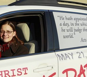 In this Dec. 17, 2010 photo in Raleigh, N.C., Allison Warden poses with her car showing a message about the rapture. Warden, of Raleigh, has been helping organize a campaign using billboards, post cards and other media in cities across the U.S. through a website, We Can Know. (AP Photo/Gerry Broome)