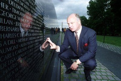 In this May 17, 1994 file photo, John Wheeler III touches the name of a friend engraved in the Vietnam Veterans Memorial in Washington. Wheeler's body was discovered Dec. 31, 2010 as a waste management truck emptied its contents at the Wilmington, Del.-area landfill. His death has been ruled a homicide. (AP Photo/Charles Tasnadi, File)