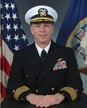 In this undated photo released by the U.S. Navy, Navy Capt. Owen Honors is shown in an official portrait. The top officer aboard a nuclear-powered aircraft carrier broadcast to his crew a series of profanity-laced comedy sketches in which he uses gay slurs, mimics masturbation and opens the shower curtain on women pretending to bathe together, a newspaper reported. The Virginian-Pilot reported in its Sunday editions that Capt. Honors appeared in the videos in 2006 and 2007 while he was the USS Enterprise's second-ranking officer, and showed them across the ship on closed-circuit television. He took over as the ship's commander in May. (AP Photo/US Navy)