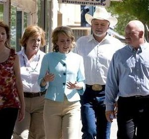 U.S. Representative Gabrielle Giffords (D-AZ) (center), who was shot during an appearance in Tucson, Arizona on January 8, 2011 is seen meeting with constituents in Douglas, Arizona in an undated 2010 handout photo provided by her congressional campaign. Rep. Giffords, 40, a Democrat, took office in January 2007, emphasizing issues such as immigration reform, embryonic stem-cell research, alternative energy sources and a higher minimum wage. Giffords was alive but in surgery at a hospital on Saturday after a shooting that also injured at least nine other people, a hospital spokeswoman said.  REUTERS/Giffords for Congress/Handout