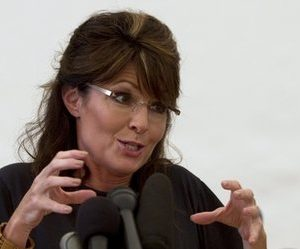Former Alaska Gov. Sarah Palin talks to the press at the Titanyan Global Outreach Samaritan's Purse compound in Cabaret, Haiti, Sunday Dec. 12, 2010.  Palin is in Haiti as part of a brief humanitarian mission in the impoverished nation struggling to overcome post-election violence and a cholera epidemic.  (AP Photo/Guillermo Arias)