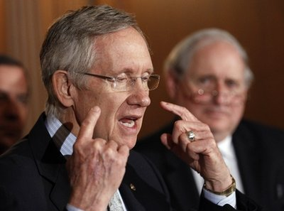"""Senate Majority Leader Sen. Harry Reid, D-Nev., left, with Sen. Carl Levin, D-Mich., speaks at a news conference about the """"Don't Ask Don't Tell"""" bill during an unusual Saturday session on Capitol Hill in Washington Saturday, Dec. 18, 2010.  Repeal of the bill would mean that, for the first time in American history, gays would be openly accepted by the military. Reid said a final vote would come at 3 p.m.  (AP Photo/Alex Brandon)"""