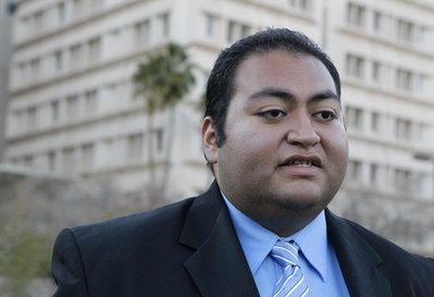 Daniel Hernandez, an intern with U.S. Rep. Gabrielle Giffords, D-Ariz., speaks outside University Hospital Sunday, Jan. 9, 2011 in Tucson, Ariz. Hernandez attended to Giffords and others immediately after Giffords was shot in the head a day earlier during a speech at a local supermarket. (AP Photo/Matt York)