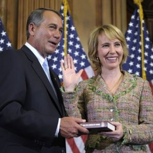 In this Jan. 5, 2011 file photo, House Speaker John Boehner reenacts the swearing in of Rep. Gabrielle Giffords, D-Ariz., on Capitol Hill in Washington. Authorities say that Giffords was shot in the head on Saturday, Jan. 8, 2011 while meeting with constituents in her district in the area around Tucson.  (AP Photo/Susan Walsh, File)