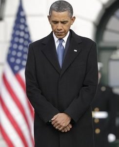 President Barack Obama observes a moment of silence for Rep. Gabrielle Giffords, D-Ariz., and the other victims of an assassination attempt against her, Monday, Jan. 10, 2011, at the White House in Washington. The shooting at a town hall-style event outside a supermarket in Tucson, Ariz., Saturday left six dead, including a federal judge, and critically wounded Rep. Gabrielle Giffords.  (AP Photo/J. Scott Applewhite)