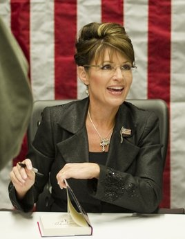 "Sarah Palin signs copies of her new book, ""America By Heart,"" in Little Rock, Ark. Palin has posted a nearly eight-minute video on her Facebook page condemning those who blame political rhetoric for the Arizona shooting that gravely wounded U.S. Rep. Gabrielle Giffords.  In the video posted Wednesday, Dec. 12, 2010, the 2008 GOP vice presidential candidate said vigorous debates are a cherished tradition. But she said after the election, both sides find common ground, even though they disagree.  (AP Photo/Brian Chilson, File)"