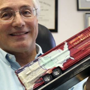 "In this March 23, 2010, file photo Sal Russo, the California-based co-founder of the Tea Party Express, holds a model of the Tea Party Express bus in his Sacramento, Calif., office.  The robust, hard-right political movement that helped drive the GOP's November triumphs still has clout, and perhaps a brilliant future. But in an January 2011 interview from Wyoming while visiting potential 2012 Senate candidates Russo said ""There's a little bit of expectation that they can do more than they really can do"", and pointed out that Democrats still control the Senate and White House. (AP Photo/Rich Pedroncelli, File)"
