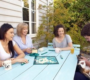 This undated photo courtesy of Frances Andrijich shows Susan Maushart, second from left, with her children, from left to right,  Anni, Sussy and Bill (with cat Hazel) as they play a board game together at the family home in Perth, Australia, before the family moved to the U.S. When Susan Maushart took away the Internet, TV, iPods, cell phones and video games for six months, she and her kids rediscovered small pleasures _ like board games, books, lazy Sundays, old photos, family meals and listening to music together.   (AP Photo/Frances Andrijich)
