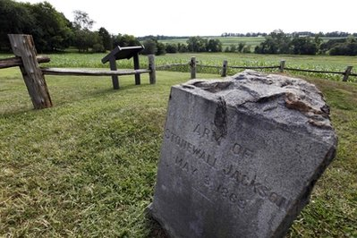 In this Aug. 7, 2009 file photo, a gravestone marker on the spot where the arm of General Stonewall Jackson is buried is near the Ellwood house in Locust Grove, Va. Civil War history will play out in a rural Virginia courtroom this week when Wal-Mart Stores Inc. defends a planned store near the hallowed site where Robert E. Lee and Ulysses S. Grant first met on a battlefield in 1864. (AP Photo/Steve Helber, File)