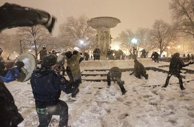 A snowball fight breaks out at Dupont Circle in Washington in the still-falling snow, Wednesday, Jan. 26, 2011. (AP Photo/Pablo Monsivais)