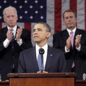 President Barack Obama is applauded by Vice President Joe Biden and House Speaker John Boehner on Capitol Hill in Washington, Tuesday, Jan. 25, 2011, while delivering his State of the Union address  (AP Photo/Pablo Martinez Monsivais, Pool)