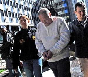 In this Oct, 13, 2010, file photo Michael Dobrushin is led in handcuffs from FBI headquarters in New York. Dobrushin is one of 73 people across the country charged by federal prosecutors in a scheme to cheat Medicare out of $163 million, the largest fraud by one criminal enterprise in the program's history, U.S. authorities said. Medicare and Medicaid scams cost taxpayers more than $60 billion a year, but the average bank holdup is likely to get more attention.  (AP Photo/Louis Lanzano, File)