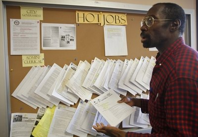 In this photo taken on on Thursday , Feb. 3, 2011, Job seeker Richard Phillips looks for a video post-production job opportunity at the Verdugo Job Center in Glendale, Calif. Finding a job remains a struggle 20 months after the recession technically ended. (AP Photo/Damian Dovarganes)