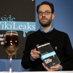 One of the founders of OpenLeaks, Daniel Domscheit-Berg, holds his book 'Inside WikiLeaks' after his arrival for a news conference in Berlin, Germany, Thursday, Feb. 10, 2011. (AP Photo/Michael Sohn)