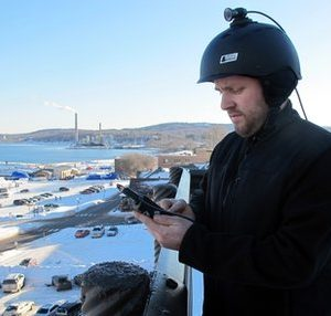 In this photo taken Tuesday, Feb. 8, 2011, Doug Pennala, logistics manager V.I.O. Inc., adjusts controls on a miniature camera the company sells from its building overlooking Lake Superior in Marquette, Mich. The helmet camera company, which sells, markets and distributes its products online, is one of the  off-the-beaten-path small businesses that owe their success to high-speed Internet access, which President Barack Obama considers a potential economic savior for America's countryside and small towns. (AP Photo/John Flesher)