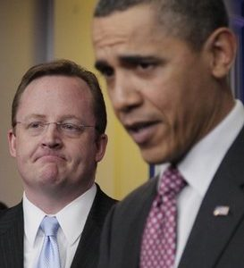 President Barack Obama, right, acknowledges outgoing White House Press Secretary Robert Gibbs, left, during the daily news briefing at the White House in Washington, Friday, Feb., 11, 2011. Gibbs steps down from the post today, after two years as Obama's top spokesman. Jay Carney, the current communications director for Vice President Joe Biden, will succeed him at the podium. (AP Photo/Carolyn Kaster)