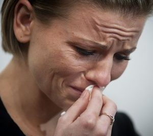 Kori Cioca, 25, of Wilmington, Ohio, speaks about how she was raped while serving in the U.S. Coast Guard, during an interview in her attorney office in Washington, Sunday, Feb. 13, 2011. Cioca is a plaintiff  among about a dozen women and at least one man, who are suing Pentagon officials, seeking change in the military's handling of rape, and sexual assault cases. (AP Photo/Cliff Owen)