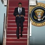 President Barack Obama walks down the stairs of Air Force One at Andrews Air Force Base, Md. on Friday, Feb. 18, 2011. (AP Photo/Cliff Owen)