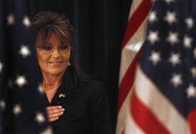 Former Alaska governor Sarah Palin looks down during the Pledge of Allegiance before speaking to the LIA (Long Island Association) Annual Meeting & Luncheon at the Crest Hollow Country Club in Woodbury, New York, February 17, 2011.  REUTERS/Shannon Stapleton