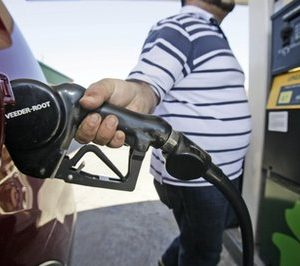 Juan Zuniga gasses up a SUV in Dallas. Gasoline prices rose more than 2 cents on Thursday to a new national average of $3.228 per gallon. (AP Photo/LM Otero, file)