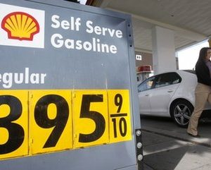 A woman gets gas at a Shell station in San Francisco, Monday, March 7, 2011. (AP Photo/Jeff Chiu)