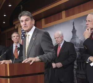 Sen. Joe Manchin, D-W.Va., center, takes a question during a news conference on Capitol Hill in Washington, Tuesday, Feb. 8, 2011, before introducing the Reduce Unnecessary Spending Act, legislation that would give the president line-item veto authority. From left are: Sen. Michael Bennet, D-Colo., Sen. Rob Portman, R-Ohio, Manchin, Sen. John McCain, R-Ariz., and Sen. Tom Carper, D-Del.  (AP Photo/J. Scott Applewhite)