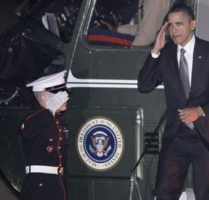 President Barack Obama returns a Marine honor guard salute as he steps off Marine One upon returning to the White House in Washington, Tuesday, March 8, 2011, after traveling to education and fundraising events in Boston. (AP Photo/Charles Dharapak)