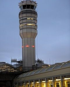 The FAA control tower at Reagan National Airport is seen in Arlington, Wednesday, March 23, 2011. Federal safety officials are investigating a report that two planes landed at the airport without control tower clearance becasue the air traffic controller was asleep. (AP Photo/Cliff Owen)