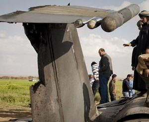 Libyans inspect the wreckage of a US  F15 fighter jet after it crashed in an open field in the village of  Bu Mariem, east of Benghazi, eastern Libya, Tuesday, March 22, 2011, with both crew ejecting safely. The U.S. Africa Command said both crew members were safe after what was believed to be a mechanical failure of the Air Force F-15. The aircraft, based out of Royal Air Force Lakenheath, England, was flying out of Italy's Aviano Air Base in support of Operation Odyssey Dawn.(AP Photo/Anja Niedringhaus)