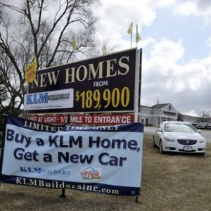 A sign at the Sunset Ridge Estates alerts buyers of special incentives when buying a KLM home in Richmond, Ill, Friday, March 25, 2011.  (AP Photo/David Banks)
