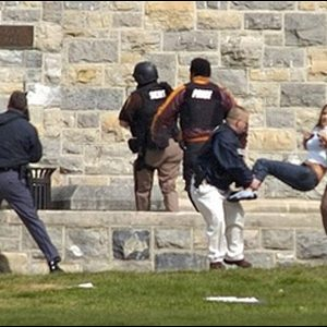Injured occupants are carried out of Norris Hall at Virginia Tech in Blacksburg, Va., Monday, April 16, 2007. A gunman opened fire in a dorm and classroom at Virginia Tech on Monday, killing 21 people before he was killed, police said. (AP Photo/The Roanoke Times, Alan Kim)