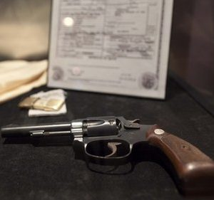 A hand gun that once allegedly belonged to mobster Bugsy Siegel is seen on display at the Mob Experience at the Tropicana, Monday, March 28, 2011, in Las Vegas.  The Mob Experience which opens Wednesday on the Las Vegas Strip, is an interactive attraction featuring gangster memorabilia and commentary from film mobsters James Caan, Mickey Rourke and Frank Vincent. Speakeasies, bootleggers, gun-wielding crime lords, easy women and gruff Italian accents pay homage to Las Vegas' mob roots in a pair of new attractions glamorizing Sin City's criminal history. (AP Photo/Julie Jacobson)