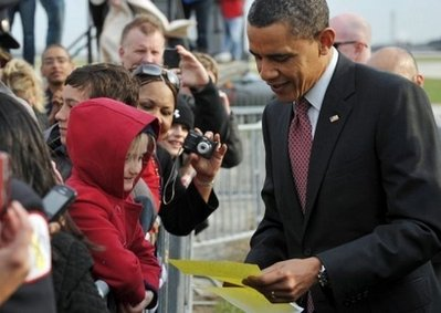Obama greets supporters as he arrives in Chicago (AFP)