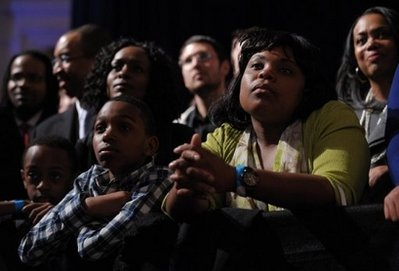 Obama supporters watch the President (AP)