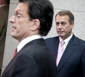 House Speaker John Boehner of Ohio looks on at right as House Majority Leader Eric Cantor of Va. speaks during a news conference on Capitol Hill in Washington, Friday, April 15, 2011. (AP Photo/Evan Vucci)