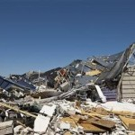 The remains of a destroyed Lowe's Home Improvement store is pictured after a tornado in in Sanford, North Carolina, April 17, 2011.  REUTERS/Chris Keane
