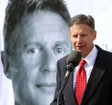 Former New Mexico Gov. Gary Johnson announces his plans to seek the Republican nomination for president in front of the Statehouse Thursday, April 21, 2011 in Concord, N.H. Gov. Johnson says he has the resume needed to lead the country. (AP Photo/Jim Cole)