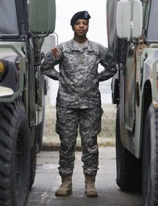 Army Maj. Sequana Robinson models a new women's combat uniform that is currently being evaluated by the Army, at Fort Belvoir, Va., in this photo taken Thursday, March 31, 2011. Imagine U.S. combat troops and aviators wearing body armor so ill-fitting it's tough to position a weapon to shoot, combat uniforms with knee pads that hit around mid-shin and flight suits in which it's nearly impossible to urinate while in flight. For many female troops, it's just another day on the battlefield as they wear clothing and protective gear designed primarily for men. Each of these issues is now getting some preliminary attention by the military. (AP Photo/Jacquelyn Martin)