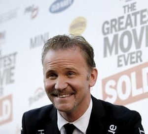 """Filmmaker Morgan Spurlock arrives at the premiere of """"Pom Wonderful Presents: The Greatest Movie Ever Sold"""" in Los Angeles on Wednesday, April 20, 2011. The documentary film which opens in theaters on April 22 explores product placement, marketing, and advertising. (AP Photo/Matt Sayles)"""