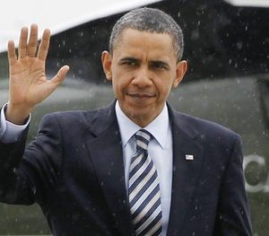 President Barack Obama walks across the tarmac in a light drizzle as he boards Air Force One in Chicago, Wednesday, April 27, 2011 to travel to New York City for campaign fundraising events. (AP Photo/Charles Dharapak)