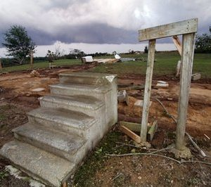 Concrete steps lead to remains of a tornado demolished mobile home in Preston,  Miss., Wednesday, April 27, 2011. The home and one next to it were blown about 100 feet away into a cow pasture. Three related women died at the site. (AP Photo/Rogelio V. Solis)