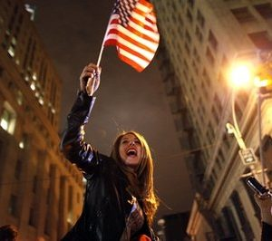 A large, jubilant crowd reacts to the news of Osama Bin Laden's death at the corner of Church and Vesey Streets, adjacent to ground zero, during the early morning hours of Tuesday, May 2, 2011 in New York. (AP Photo/Jason DeCrow)