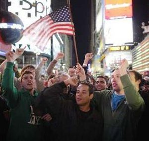 New Yorkers celebrate at Times Square (Reuters/Chip East)