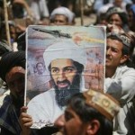A supporter of the Pakistani religious party Jamiat-e-ulema-e-Islam holds an image of Osama bin Laden during an anti-U.S. rally on the outskirts of Quetta, May 6, 2011. ( REUTERS/Naseer Ahmed)