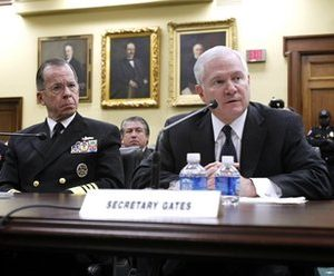 "Defense Secretary Robert Gates with Joint Chiefs Chairman Adm. Mike Mullen, left, testifies on Capitol Hill in Washington before the House Appropriations Committee. ""Health care is eating the department alive,"" Gates said bluntly two years ago. The explosive expense of health care rivals what the Pentagon shells out to buy fighter aircraft, submarines and high-tech weapons, and is about half of the $118 billion that the Obama administration wants in the next budget to fight the wars in Iraq and Afghanistan.  (AP Photo/Jose Luis Magana)"
