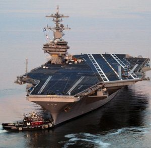 This photo provided by the U.S. Navy shows the Nimitz-class aircraft carrier USS George H.W. Bush (CVN 77) departing Naval Station Norfolk for its maiden deployment Wednesday, May 11, 2011.  The United States' newest aircraft carrier embarked on its maiden deployment under the leadership of the first woman to ever command a carrier strike group. (AP Photo/U.S. Navy, MC3 Nicholas Hall)